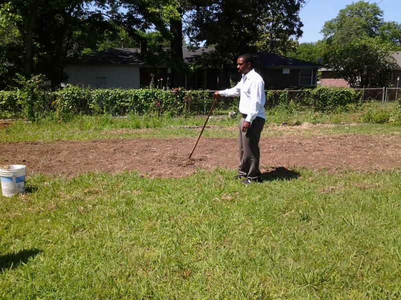 Pastor Charles leads us in prayer at the site of our garden.
